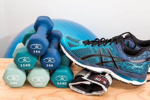 dumbbells and sneakers. Fitness